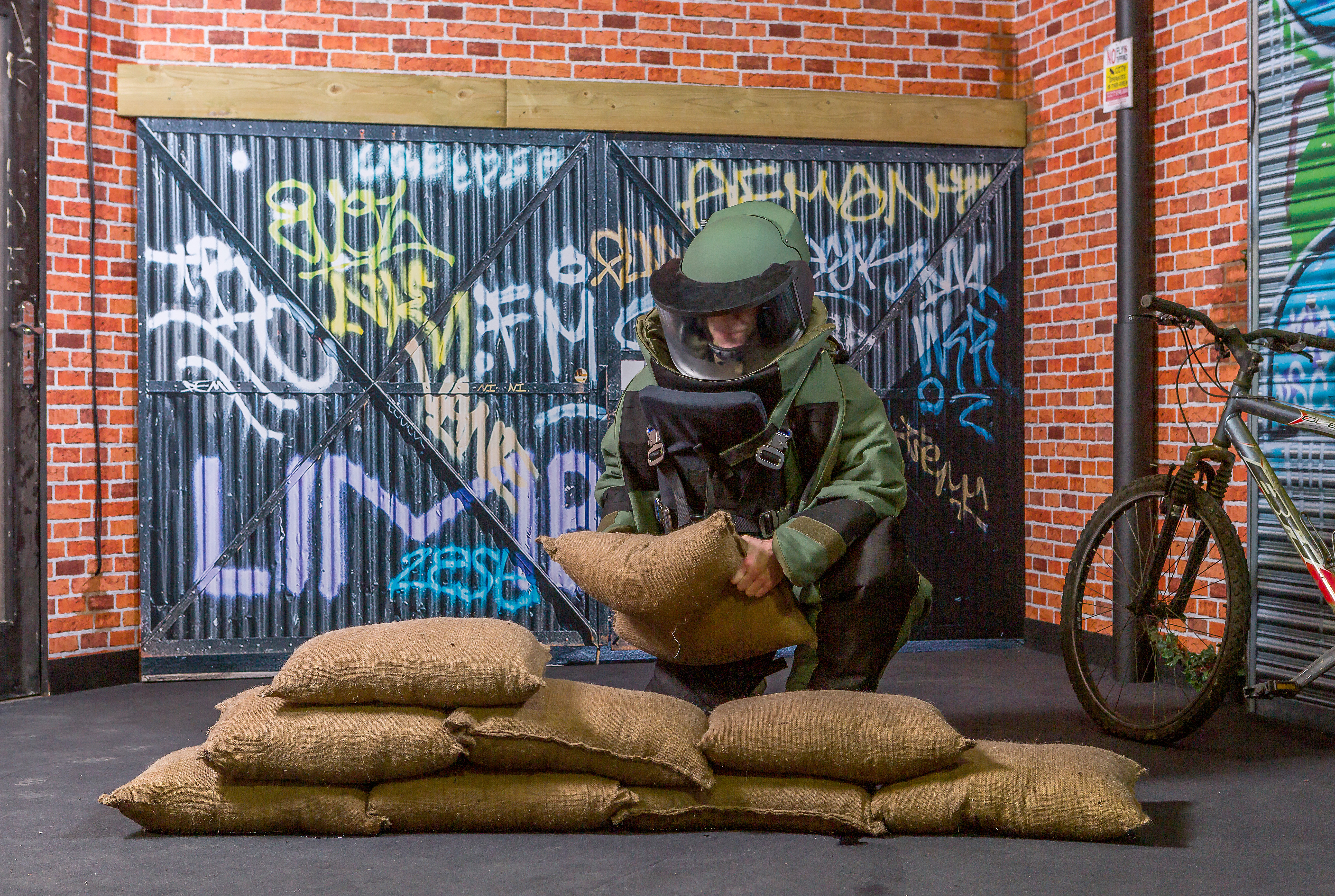 BlastSax April 2019 with soldier in protective equipment building a wall of Blastsax 2.jpg